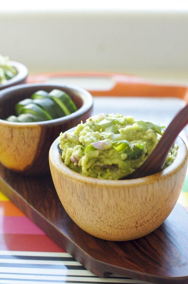 Lime-Lovin' Guacamole (AIP Paleo, AI Keto) Up close in brown bowl served with cucumber slices